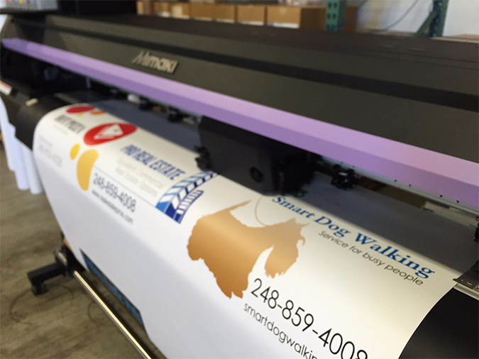 Inkjet printer producing multiple images on a large sheet of adhesive back vinyl