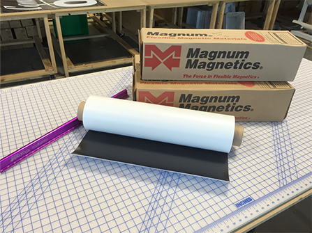 Magnum Magnetics rolls and boxes laying on proudction table at Printastic