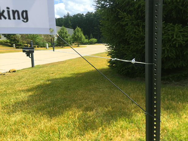 bungee cord attached from banner to pole